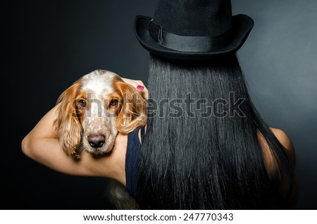 Portrait of a dog breed Russian Spaniel  on the shoulder of a woman  - stock photo