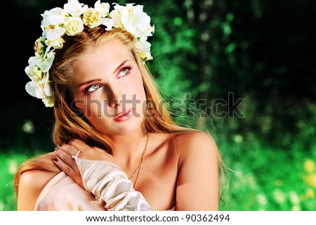 Portrait of a dreamy fairy girl outdoor. - stock photo