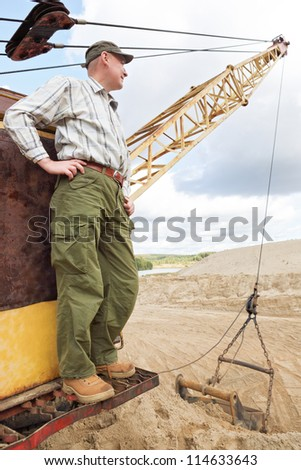 Portrait of a driver of construction equipment - stock photo
