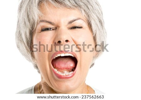Portrait of a elderly woman with a yelling expression - stock photo
