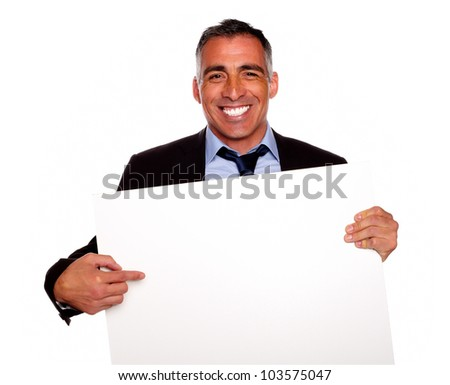 Portrait of a elegant executive man smiling and holding a white card with copyspace while having fun on isolated background - stock photo