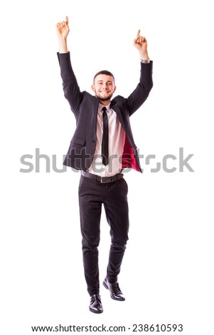 Portrait of a energetic young business man enjoying success - stock photo