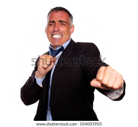 Portrait of a excited hispanic business man boxing on isolated background - stock photo