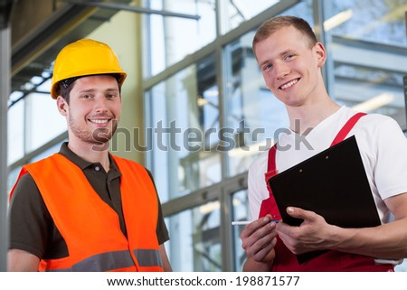 Portrait of a factory workers and the project manager - stock photo
