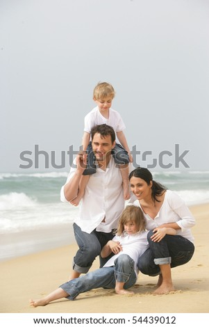 Portrait of a family by the edge of the sea - stock photo