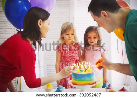 Portrait of a family celebrating birthday of their little daughter. Family fun concept - stock photo