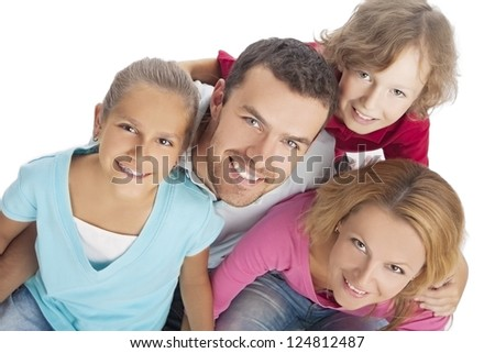portrait of a family looking up and smiling happily over pure white background - stock photo