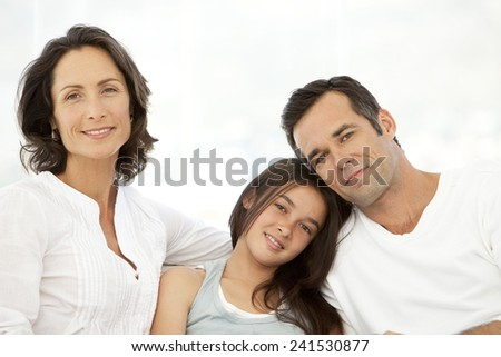 Portrait of a family with one child - stock photo