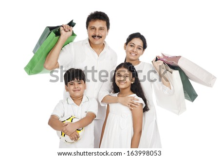 Portrait of a family with shopping bags - stock photo