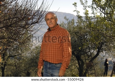 portrait of a farmer in the country - stock photo