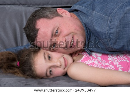 Portrait of a father and his daughter - stock photo