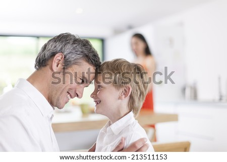 portrait of a father and his little boy indoors - stock photo