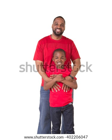 Portrait of a father bonding with his school aged son  - stock photo