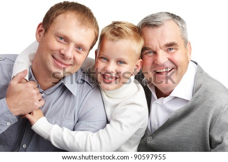 Portrait of a father, grandfather and son embracing - stock photo
