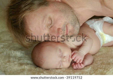 Portrait of a father with baby - stock photo