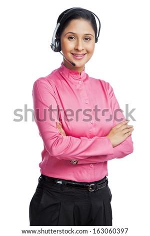 Portrait of a female customer service representative with her arms crossed - stock photo