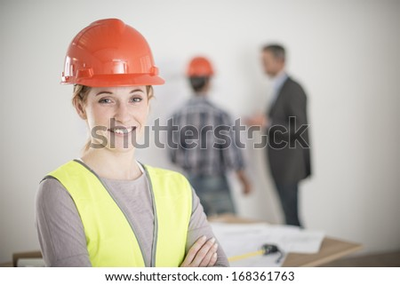 portrait of a female foreman during a meeting about a build project - stock photo