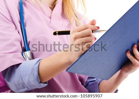 Portrait of a female nurse looking at a case history - stock photo