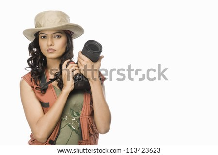 Portrait of a female photographer with digital camera - stock photo