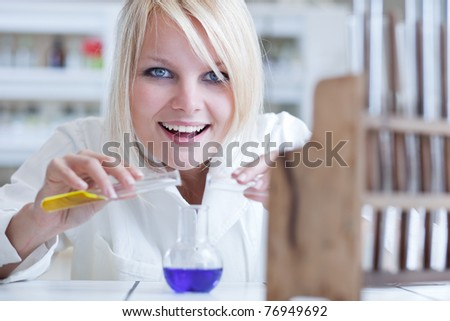 portrait of a female researcher doing research in a lab (color toned image) - stock photo