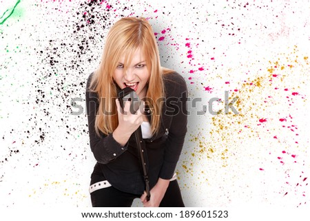 Portrait of a female singer over graffiti background - stock photo