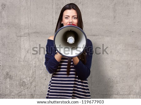 Portrait Of A Female With Megaphone, Background - stock photo