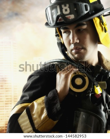 Portrait of a fire fighter - stock photo