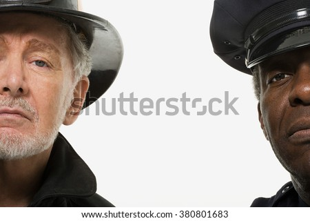 Portrait of a firefighter and a police officer - stock photo