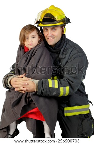 Portrait of a fireman holding a little girl with a blanket wrapped around her. - stock photo
