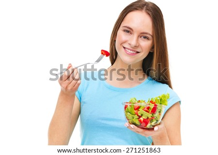 Portrait of a fit healthy woman eating a fresh salad isolated on white background. - stock photo