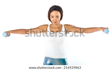 Portrait of a  fit young lady working out with dumbbells - stock photo
