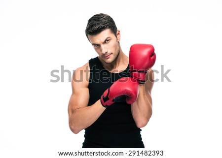 Portrait of a fitness man wearing red boxing gloves isolated on a white background. Looking at camera - stock photo