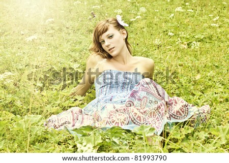 Portrait of a fresh and lovely young woman in summer garden. Fashion shot - stock photo