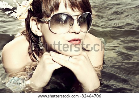 Portrait of a fresh and lovely young woman wearing sunglasses - stock photo