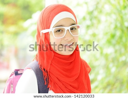 Portrait of a fresh beauty arabian school teenage girl with hijab - stock photo