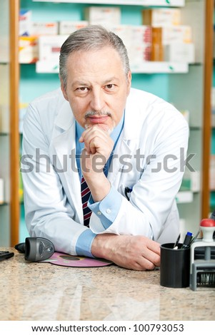 Portrait of a friendly chemist in his store - stock photo