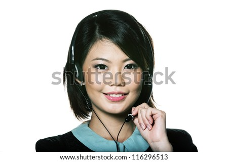 Portrait of a friendly Chinese receptionist wearing headset. Isolated on white. - stock photo
