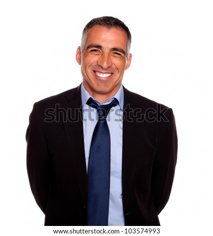 Portrait of a friendly hispanic businessman on black suit smiling with the arms on the back against white background - stock photo