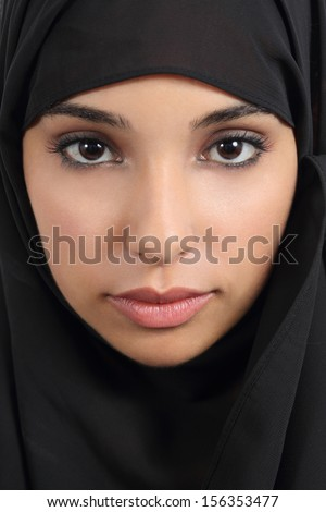 Portrait of a front view of a beautiful arab woman face with a black scarf      - stock photo