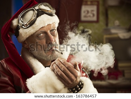 Portrait of a frowning Bad Santa smoking a joint - stock photo