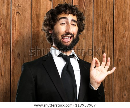 Portrait Of A Funny Businessman against a wooden background - stock photo