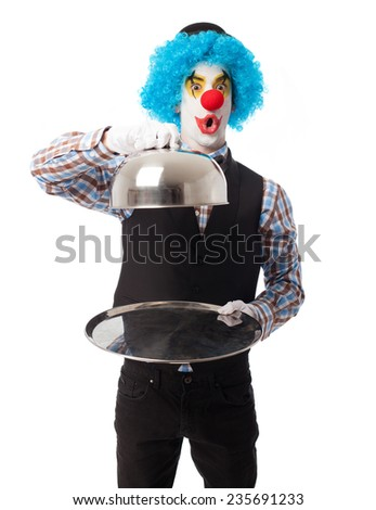 portrait of a funny clown presenting an object - stock photo