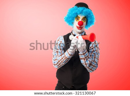 portrait of a funny clown with a whistle - stock photo
