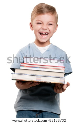 Portrait of a funny little boy holding a books over white background - stock photo