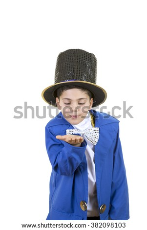 Portrait of a funny little boy in mad hatter costume while sending a kiss against isolated white background. - stock photo