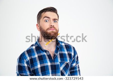 Portrait of a funny man with pencil in beard isolated on a white background - stock photo