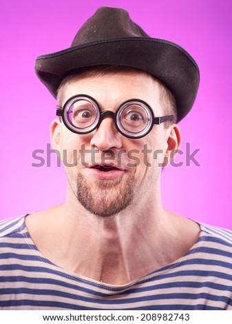 Portrait of a funny nerd guy in hat - stock photo