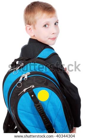 Portrait of a funny schoolboy with his bag. - stock photo