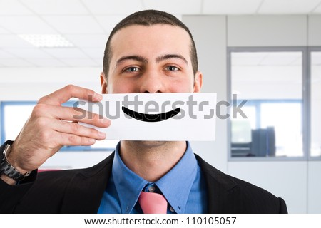 Portrait of a funny smiling businessman - stock photo