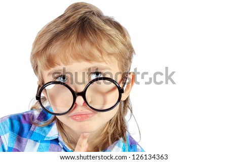 Portrait of a funny 9 year boy in big round spectacles. Isolated over white background. - stock photo